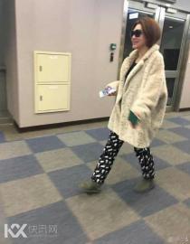 小S大衣配睡裤坐飞机:这就是真正的时尚!
